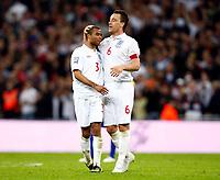 England's John Terry celebrates his  Goal with AshleyCole. World Cup Qualifer England v Ukraine at Wembley Stadium 01/04/2009. Credit  Colorsport / Kieran Galvin