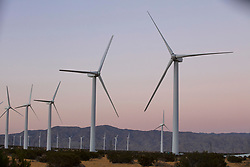 Turbines on wind farm in Palm Springs, California at sunset.