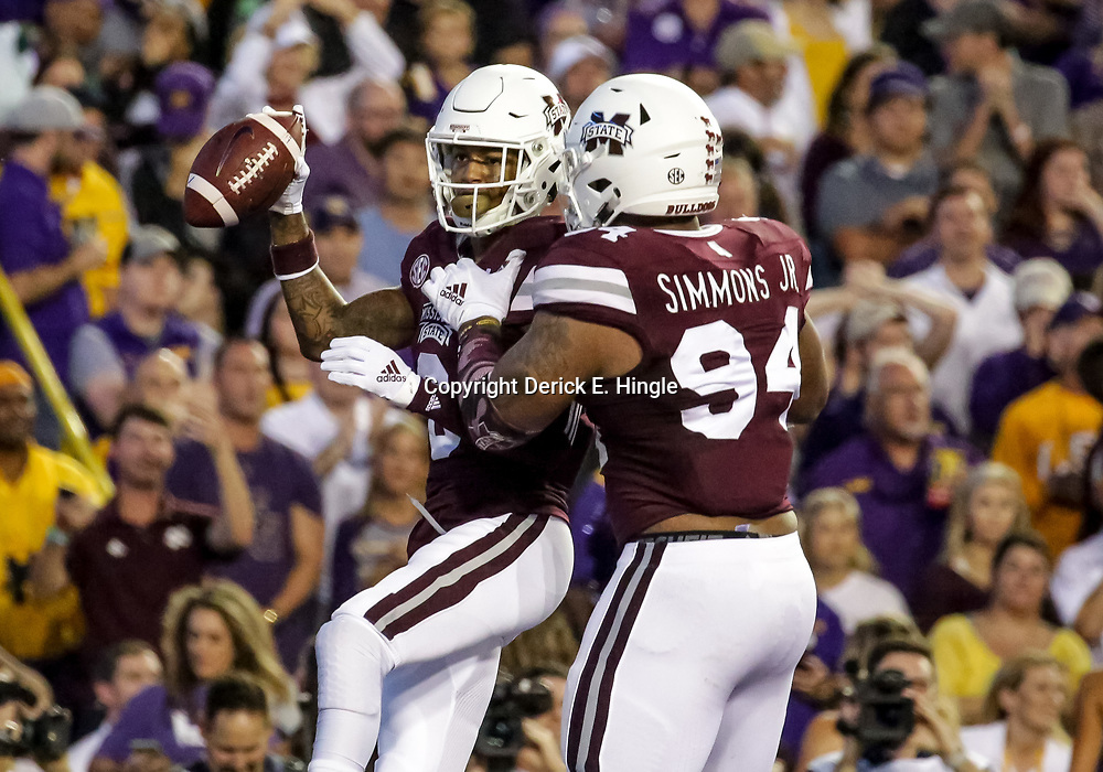 Oct 20, 2018; Baton Rouge, LA, USA; Mississippi State Bulldogs cornerback Cameron Dantzler (3) celebrates with defensive tackle Jeffery Simmons (94) after a interception against the LSU Tigers during the first quarter at Tiger Stadium. Mandatory Credit: Derick E. Hingle-USA TODAY Sports
