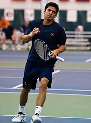 Virginia's Sanam Singh celebrates during the #1 doubles game against VT.  The #1 ranked Virginia Cavaliers faced the #31 ranked Virginia Tech Hokies in NCAA Men's Tennis at the Boar's Head Sports Club in Charlottesville, VA on February 27, 2009.