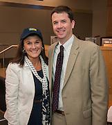 Dr. Andrew Houlihan, right, recognizes Pin Oak Middle School principal Susan Monaghan, left, during a principal meeting, April 9, 2014.