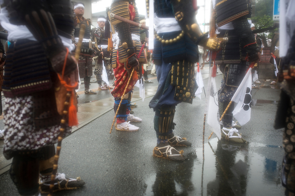 """MINAMISOMA, JAPAN - JULY 24 :  A samurai men pays respect for the ritual ceremony during the """"Hon Matsuri"""", Soma Nomaoi festival at Minamisoma city on Sunday, July 24, 2016 in Fukushima Prefecture, Japan. """"Soma-Nomaoi"""" is a three day traditional festival that recreates a samurai battle scene from more than 1,000 years ago. The festival has gathered more than thousands visitors as Fukushima still continues to recovery from the 2011 nuclear disaster, the samurai warriors battles for recovery of the area. (Photo: Richard Atrero de Guzman/NURPhoto)"""
