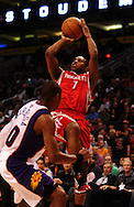 Jan. 6 2010; Phoenix, AZ, USA;  Houston Rockets guard (7) Kyle Lowry puts up a shot against the Phoenix Suns in the first half at the US Airways Center. Phoenix Suns defeated the Houston Rockets 118-110. Mandatory Credit: Jennifer Stewart-US PRESSWIRE