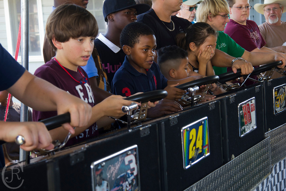 Kids race with electric Nascars on a mini track at the Sylvester, Ga., Peanut Festival on October 15, 2011.