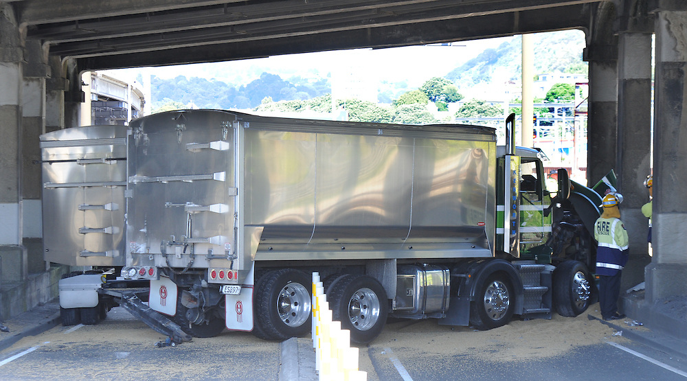 A truck and trailer unit has crashed on the motorway ramp to to SH1 next to the Interislander Ferry Terminal spilling its payload of grain onto the road, Wellington, New Zealand, Tuesday, January 22, 2012. Credit:SNPA / Ross Setford