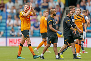 Hull City defender Reece Burke (5) applauds the Hull City football fans, football supporters as he walks off the pitch injured during the EFL Sky Bet Championship match between Millwall and Hull City at The Den, London, England on 31 August 2019.