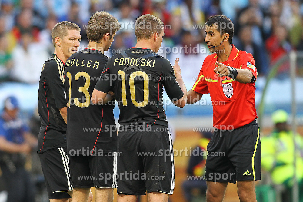 03.07.2010, CAPE TOWN, SOUTH AFRICA, im Bild Referee Ravshan Irmatov (UZB) warns the German wall of Bastian Schweinsteiger, Thomas Mueller and Lukas Podolski of Germany during the Quarter Final, Match 59 of the 2010 FIFA World Cup, Argentina vs Germany held at the Cape Town Stadium..Foto ©  nph /  Kokenge