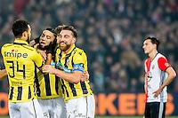 ROTTERDAM - Feyenoord - Vitesse , Voetbal , Eredivisie , Seizoen 2016/2017 , De Kuip , 16-12-2016 , Vitesse speler Adnane Tighadouini (l) viert met de 1-1 met zijn medespelers terwijl Feyenoord speler Steven Berghuis (r) baalt
