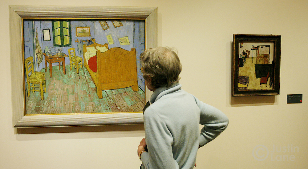 A woman looks at Vincent van Gogh's 'The Bedroom' (L) and Egon Schiele's 'The Artist's Bedromm in Neulengbach' (R) at an exhibit exploring the influence of Vincent van Gogh on German and Austrian Expressionism at the Neue Galerie in New York, New York on Wednesday 21 March 2007. The exhibit, which features over 80 major paintings, will be open until 2 July 2007.