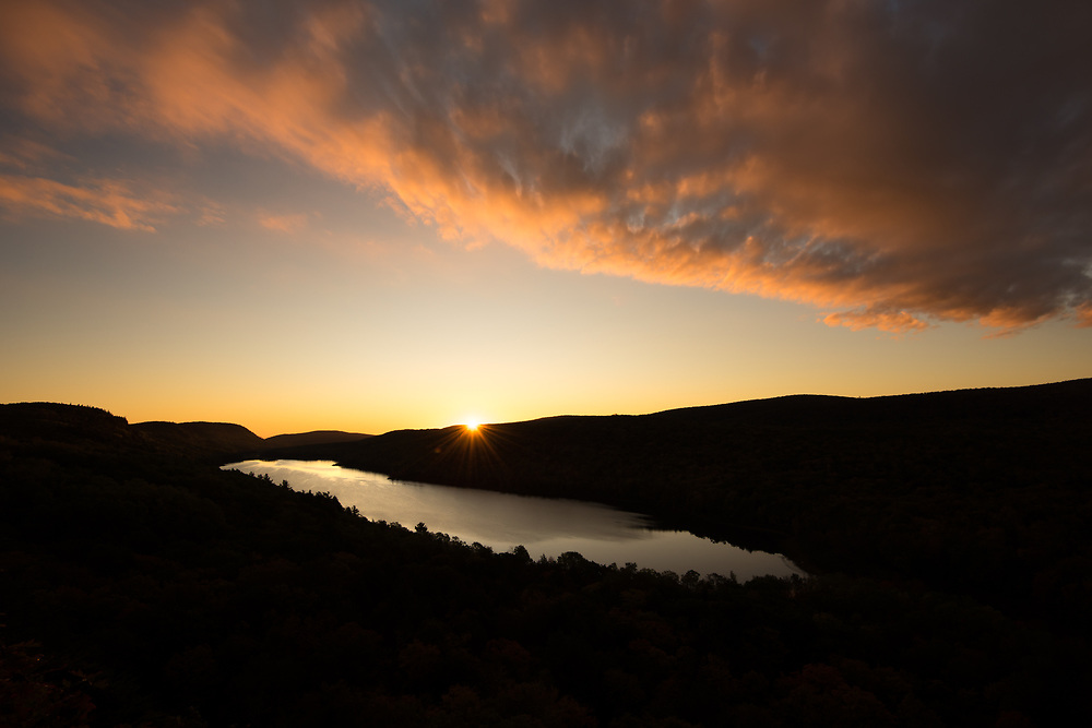 The sun appears over the horizon in the Porcupine Mountains - Michigan's Upper Peninsula