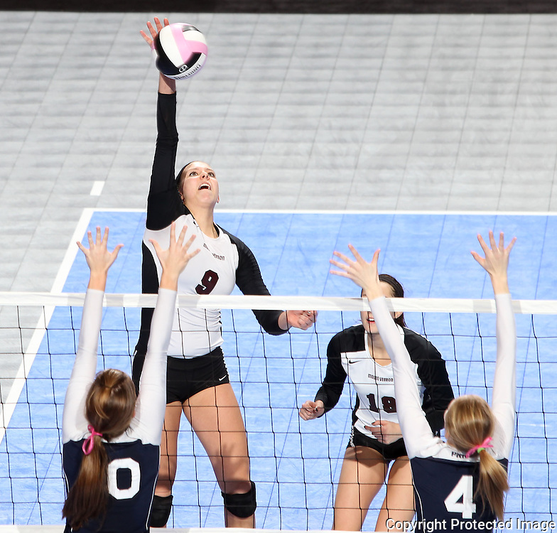 Mount Vernon's Taylor Dicus (9) goes up for a kill during the fourth game of a 3A semifinal in the state volleyball tournament at the U.S. Cellular Center at 370 1st Ave E on Friday afternoon, November 12, 2010. (Stephen Mally/Freelance)