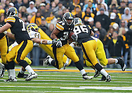 November 05, 2011: Iowa Hawkeyes running back Marcus Coker (34) tries to avoid Michigan Wolverines linebacker Desmond Morgan (44) during the second quarter of the NCAA football game between the Michigan Wolverines and the Iowa Hawkeyes at Kinnick Stadium in Iowa City, Iowa on Saturday, November 5, 2011. Iowa defeated Michigan 24-16.
