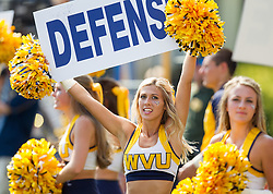 Sep 10, 2016; Morgantown, WV, USA; A West Virginia Mountaineers cheerleader holds a sign during the second quarter against the Youngstown State Penguins at Milan Puskar Stadium. Mandatory Credit: Ben Queen-USA TODAY Sports