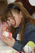 Brittany Minton, 11, who attends Ridgeville Christian School works on her candle at the American Girl Tea Party, Saturday, January 27, 2007 in Waynesville's Mary L. Cook Library.