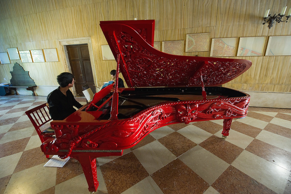 """VENICE, ITALY - MAY 31: """"Story of a New Zealand River"""" a carved Steinway piano by New Zealand artist Michael Parekowhai at Palazzo Loredan dell'ambasciatore on May 31, 2011 in Venice, Italy. This year's Biennale, the 54th edition, will  officially open  on Saturday June 4th, after several days of press previews, and will run until 27 November"""