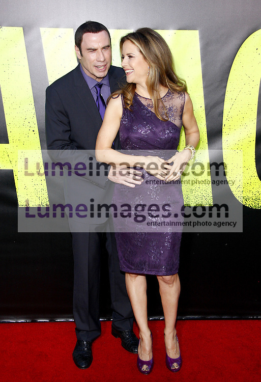 """John Travolta and Kelly Preston at the Los Angeles premiere of 'Savages"""" held at the Mann Village Theatre in Westwood on June 25, 2012. Credit: Lumeimages.com"""