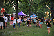 People gather on the second Friday of each month from May through October for the annual Sauce Food Truck Friday evening celebrations in Tower Grove Park; St. Louis, MO