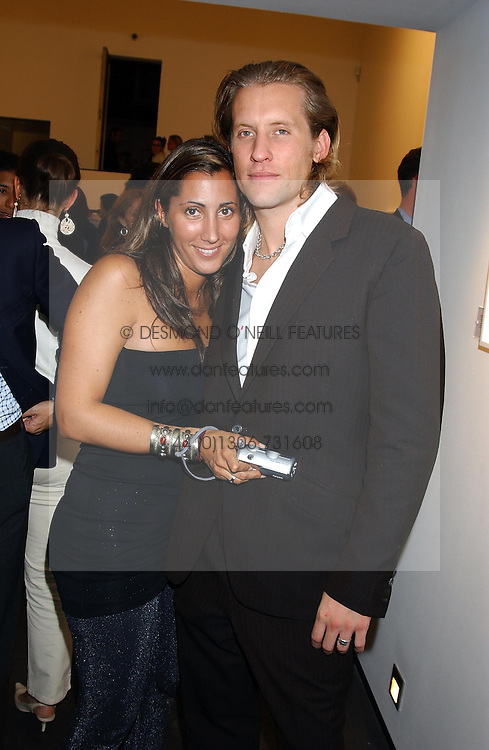 MISS SAMIRA BEAVIS and JAKE PARKINSON-SMITH grandson of Norman Parkinson at a party to celebrate the opening of an exhibition of photographs by the late Norman Parkinson held at Hamiltons gallery, 13 Carlos Place, London W1 on 14th September 2004.<br /><br />NON EXCLUSIVE - WORLD RIGHTS