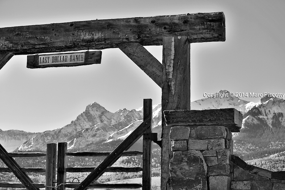 SHOT 10/2/14 9:15:42 AM - The Last Dollar Ranch entryway and jagged  peaks of the Sneffels Range along the Dallas Divide near Telluride, Co. Last Dollar Ranch is a 392-acre ranch that borders a 13,000-acre property owned by clothing magnate Ralph Lauren Ralph Lauren . Last Dollar Ranch has fields of wildflowers, irrigated meadows and groves of aspen where deer, elk, bear and other wildlife live. There is also a three-acre trout pond. During the last 20 years, the ranch has been used as a location for national advertising campaigns for Anheuser-Busch, Coors and Marlboro.<br /> (Photo by Marc Piscotty / &copy; 2014)