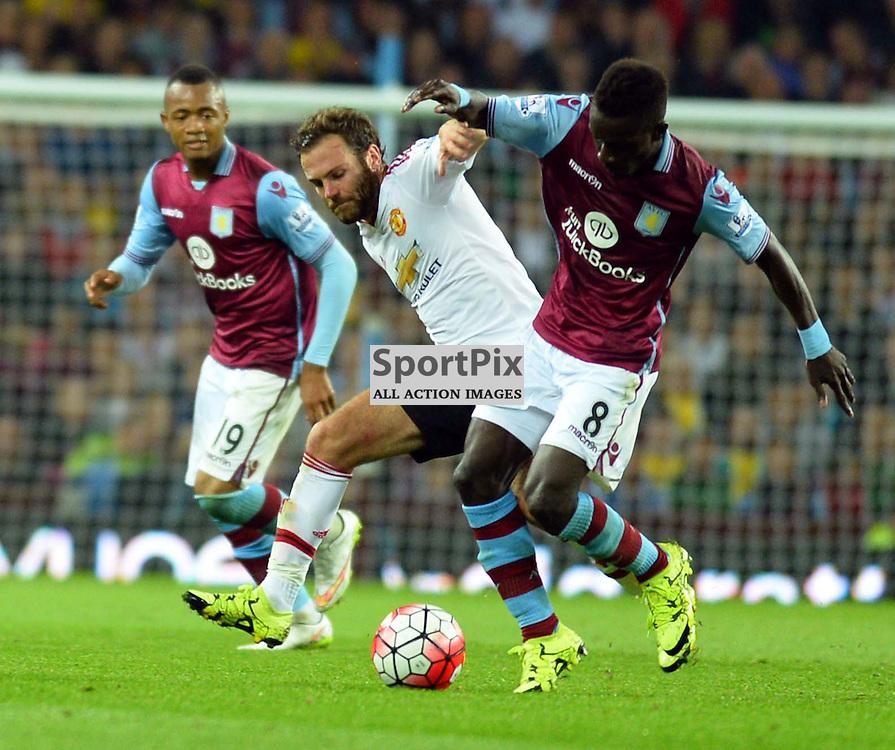 Juan Mata is challenge by Villa player Idrissa Gueye