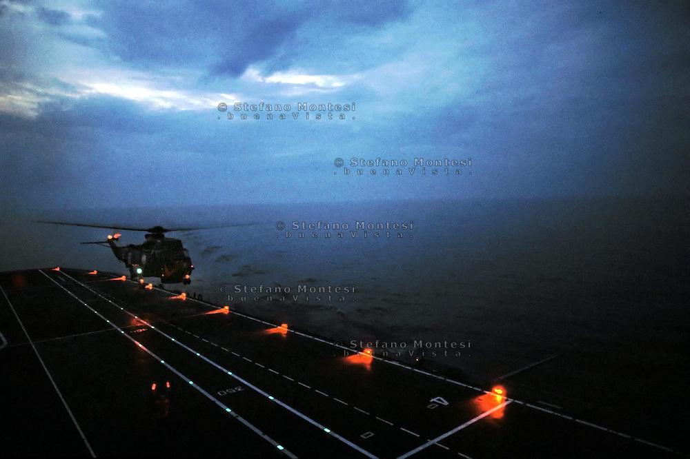 "The Italian aircraft carrier  ""G. Garibaldi""..Antisubmarine helicopters SH-3D in flight night"