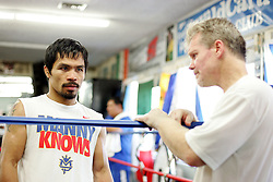 ** Exclusive images **<br /> <br /> The strain is evident between Manny Pacquiao and his trainer Freddie Roach whilst the seven time World Champion begins a training session at the Wildcard Gym in Los Angeles.  Manny Pacquiao's training for his Light Middleweight fight with Antonio Margarito has been plagued with distractions leading Freddie Roach, Alex Ariza and promoter Bob Arum wondering if the Pacman is fully prepared to win a historic 8th world title at different weights. 3rd November 2010.
