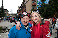 Whistler Mayor Ken Melamed smiles with olympic athlete Julia Murray in Whistler Village during the 2010 Olympic Winter Games in Whistler, BC Canada.