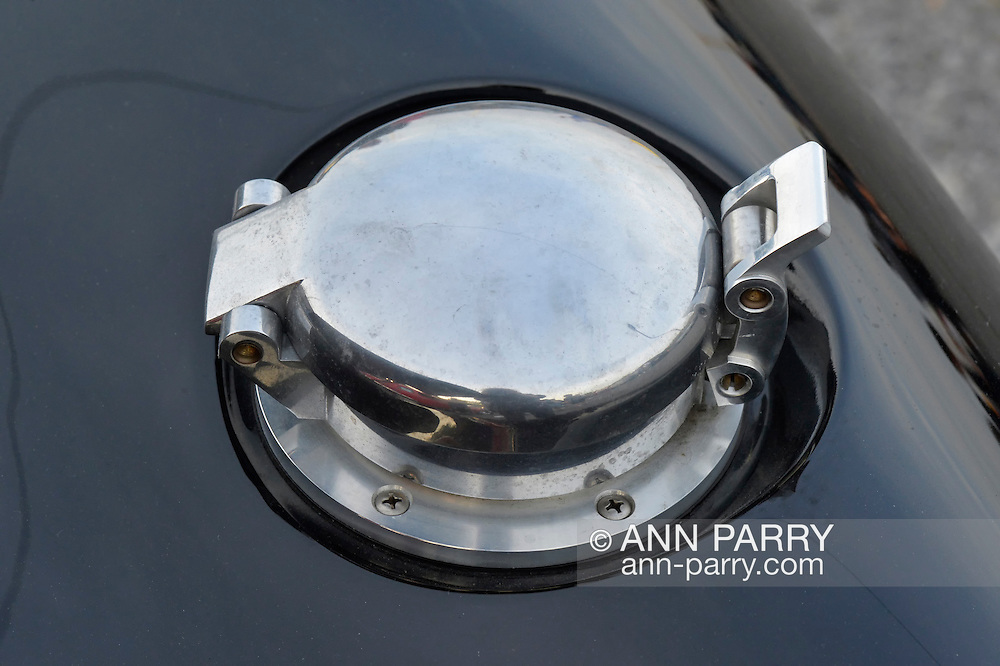 Bellmore, New York, USA. May 29, 2015. Closeup of gas cap on an original Black 1965 Shelby Cobra 427 roadster race car is shown at the Friday Night Car Show, held at the Bellmore Long Island Railroad Station Parking Lot. Hundreds of classic, antique, and custom cars are generally on view at the free weekly show, sponsored by the Chamber of Commerce of the Bellmores, from May to early October.