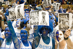 "Feb. 07, 2007; Durham, NC, USA; Duke Blue Devils fans, the Cameron Crazies, hold up pictures of North Carolina Tar Heels forward (50) Tyler Hansbrough and Jim Henson character ""Beaker"" at Cameron Indoor Stadium in Durham, NC."