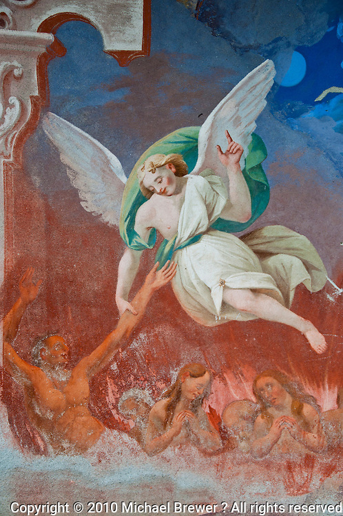 Ticino, Southern Switzerland. Frieze of an angel rescuing souls, in a church in Avegno.