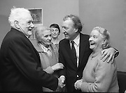 Image of Fianna Fáil leader Charles Haughey touring West Cork during his 1982 election campaign...04/02/1982.02/04/82.4th February 1982..Coming of age:..While there he calls at St Michael's Centre for Old Folk, Bandon. Here he is snapped being greeted by John O'Driscoll and Margaret Deasey to his right, and by the centre's director, Dorothy Beamish to his left. Lena Beamish can be seen standing to the rear of the group.