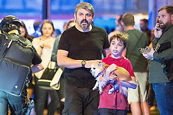 © Licensed to London News Pictures . Manchester, UK.  FILE PICTURE DATED 22/05/2017 as Manchester prepares to mark a year since the Manchester Arena terror attack . ANDREW ROUSSOS (with beard) with his son XANDER (carrying dog) outside the Manchester Arena following a bomb attack that killed 22 . Mr Roussos' daughter, Saffie Roussos , was the youngest of those killed in the attack and who would have turned nine today (4th July 2017) . Mr Roussos has spoken publicly about the impact of the Manchester Arena terrorist attack which killed his daughter, in an interview for the BBC's Victoria Derbyshire . Photo credit : Joel Goodman/LNP
