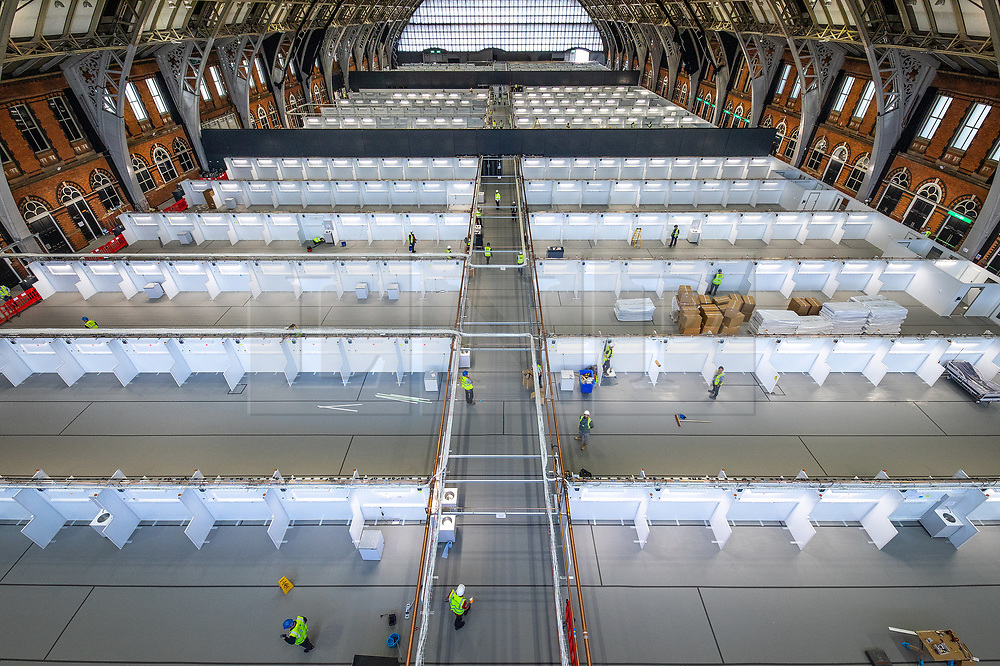© Licensed to London News Pictures. 10/04/2020. Manchester, UK. The National Health Service is building a 648 bed field hospital for the treatment of Covid-19 patients , at the historical railway station terminus which now forms the main hall of the Manchester Central Convention Centre . The facility is due to open next week and will treat patients from across the North West of England , providing them with general medical care and oxygen therapy after discharge from Intensive Care Units . Photo credit: Joel Goodman/LNP