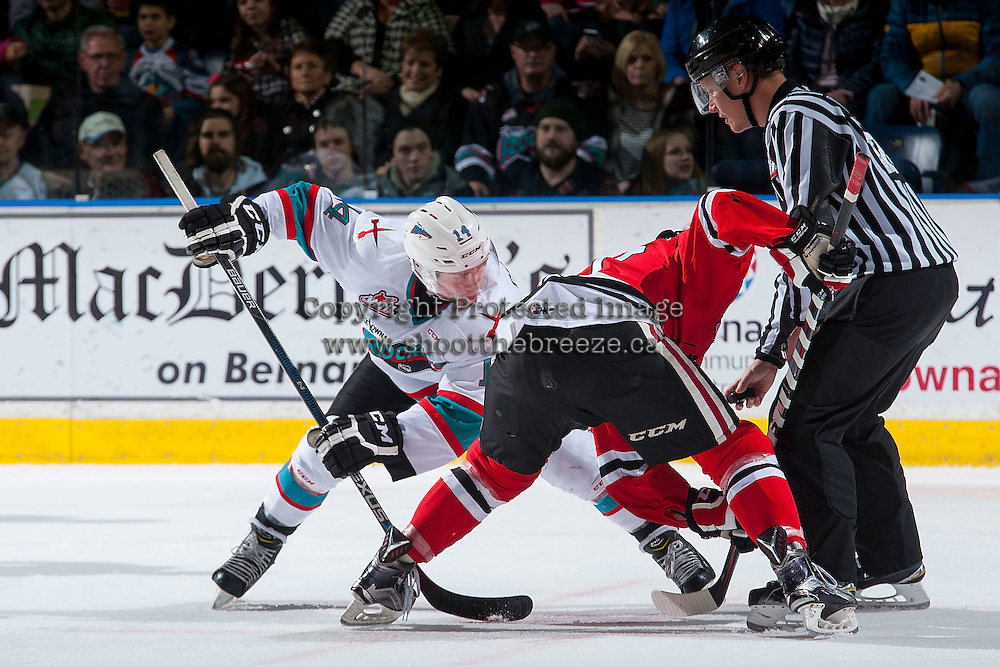 KELOWNA, CANADA - JANUARY 29: Rourke Chartier #14 of Kelowna Rockets faces off against the Portland Winterhawks on January 29, 2016 at Prospera Place in Kelowna, British Columbia, Canada.  (Photo by Marissa Baecker/Shoot the Breeze)  *** Local Caption *** Rourke Chartier;