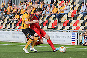Newport County forward Scott Boden and York City defender Eddie Nolan battle for the ball during the Sky Bet League 2 match between Newport County and York City at Rodney Parade, Newport, Wales on 5 September 2015. Photo by Simon Davies.