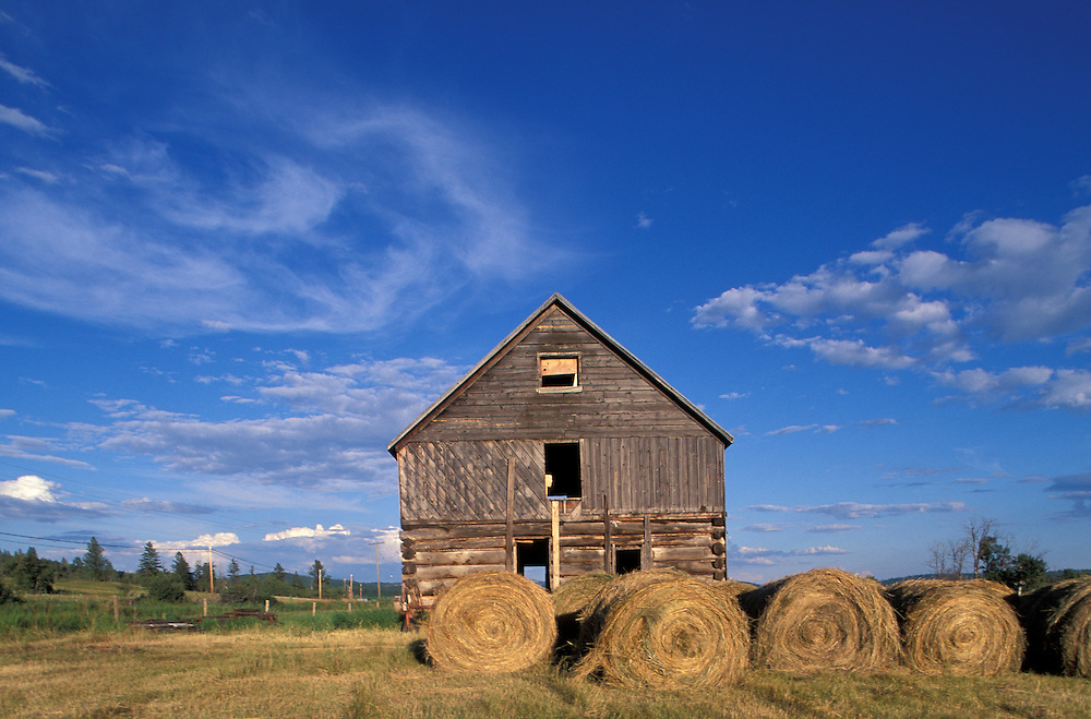 Canada, British Columbia, Old barn and bales of hay at 108 Mile Ranch Heritage Site near town of 100 Mile House