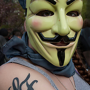 Masked female &quot;Anonymous&quot; protester, at the &quot;May Day Rally and Protest in Union Square Park&quot;  protest on May 1, 2015.<br />
