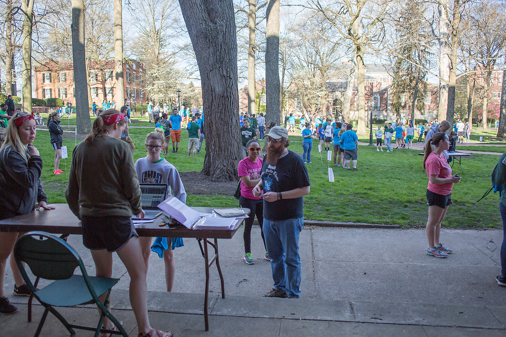 Volunteers check in at the beginning of Athens Beautification Day on April 17, 2016.