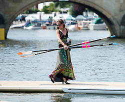 © London News Pictures. 05/07/2012.  Henley-on-Thames, UK. Katie Steenman carrying rowing oars for her partner Julian Bahain before he races on day three of Henley Royal Regatta on the River Thames at Henley-on-Thames, Oxfordshire on July 03, 2013. The 5 day regatta over the first weekend in July, races head-to-head knock out competitions over a course of 1 mile between rowing teams from throughout the world. Photo credit: Ben Cawthra/LNP