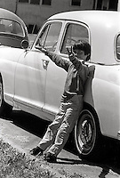 child holding up hands in  peace at Peoples Park  Student protest & riots in Berkeley California 1969