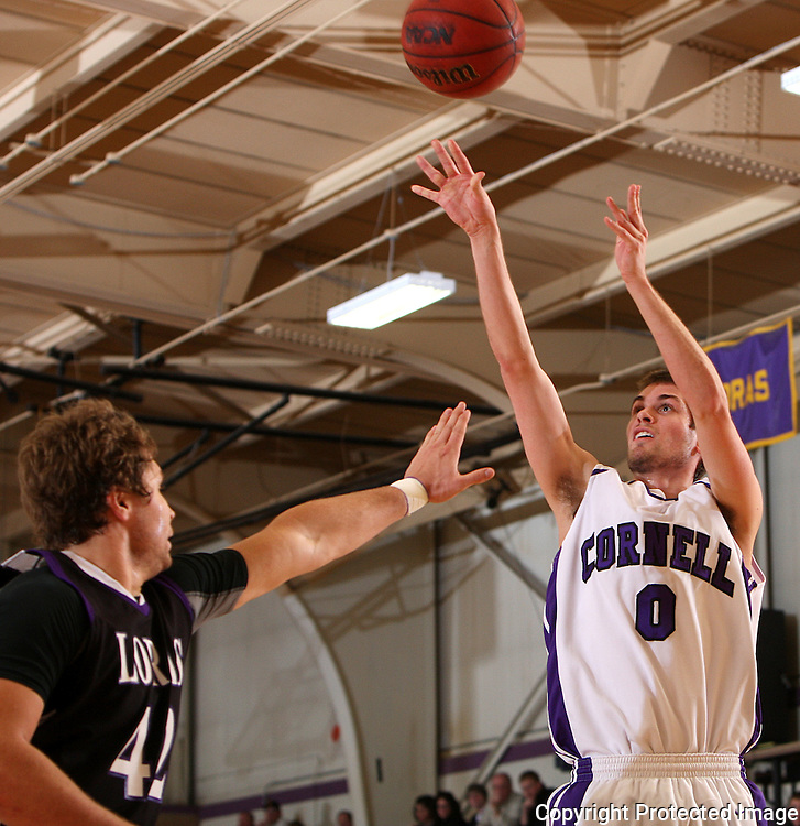 Cornell's Griffin LaDew (0) shoots a basket as Loras' Alex Brant (42) defends in the second half their IIAC Tournament Semifinal game at Cornell College in Mount Vernon on Thursday February 26, 2009. Cornell won 65-60.