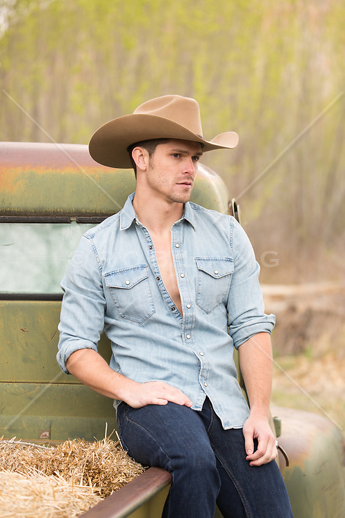 sexy cowboy by a flat bed truck