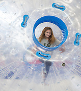 Marina Adams, 11, of Canal Winchester, Ohio, races her sister in an inflatable human hamster ball at the Sibs Bash in Walter Fieldhouse on February 6, 2016. Photo by Emily Matthews