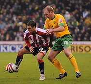 Sheffield - Saturday January 9th, 2009: Billy Sharp of Sheffield United and Gary Doherty of Norwich City during the Coca Cola Championship match at Bramall Lane, Sheffield. (Pic by Alex Broadway/Focus Images)