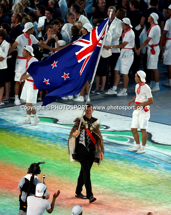 The opening ceremony of the 2008 Olympic Games in Beijing gets underway with a spectacular show introducing athletes from all over the world. The New Zealand team walk into the stadium led by flag bearer Mahe Drysdale. 8 August 2008. Photo: Lawrence Smith/PHOTOSPORT