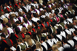 File photo dated 27/06/08 of students at a University graduation ceremony. The proportion of firsts handed out by UK universities has soared, with a third of institutions now grading at least one in four degrees with the top honour.