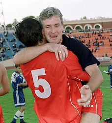 MINSK, BELARUS - Saturday, September 4, 1999: Wales's manager Mark Hughes and defender Chris Coleman celebrates the victory over Belarus in Mark Hughes' first game in charge during the UEFA Euro 2000 Qualifying Group One match at the Dinamo Stadium. (Mandatory credit: David Rawcliffe/Propaganda)