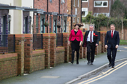 © Licensed to London News Pictures . 04/02/2014 . Sale , UK . L-R Rachel Reeves , Mike Kane and Chris Bryant arrive . Rachel Reeves , MP for Leeds West and Shadow Secretary of State for Work and Pensions and Chris Bryant , MP for Rhondda and Shadow Minister for Welfare Reform , join Labour candidate Mike Kane on the campaign trail ahead of the Wythenshawe and Sale East by-election , following the death of MP Paul Goggins . They visit the home of Tony Gunning (51) who suffers from hereditary adult polycystic kidney disease and is on dialysis , who says he is affected by the bedroom tax . Photo credit : Joel Goodman/LNP