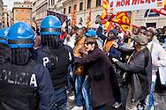 """Roma, 23 Marzo 2015<br /> Manifestazione di migranti richiedenti asilo che chiedono un  permesso di soggiorno umanitario per tutti, un'accoglienza dignitosa  e la possibilità di un lavoro per tutti e per dire «no allo sfruttamento e al business dell'accoglienza». La manifestazione è organizzata dal sindacato  Usb.  Momenti di tensione tra manifestanti e polizia davanti alla prefettura.<br /> Rome, March 23, 2015<br /> Demonstration by asylum-seeking immigrants who they ask  a humanitarian residence permit for all , decent reception and the possibility of a job for everyone and say """"no to exploitation and to the business of hospitality."""" The protest  is organized by the union Usb. Moments of tension between demonstrators and police outside the prefecture."""