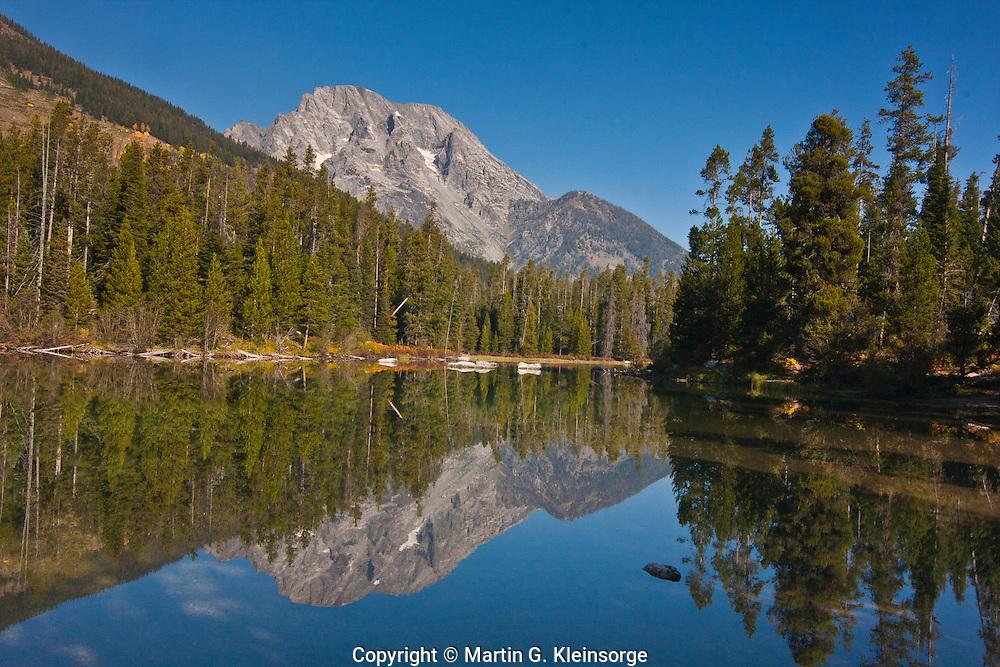Reflections of 12,605 ft. Mount Moran in String Lake, Grand Teton National Park, Wyoming, USA.